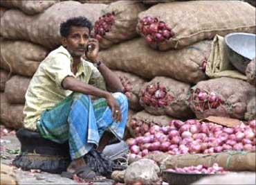 An onion vendor speaks on his mobile phone.