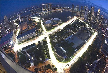 An aerial view shows the illuminated Marina Bay street circuit of the Singapore Formula One Grand Prix.