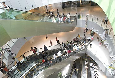 Shoppers use escalators at a shopping centre in Singapore.