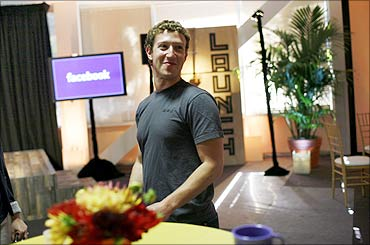 Facebook CEO Mark Zuckerberg walks through Facebook headquarters prior to unveiling the company's new location services feature called 'Places' at a news conference in Palo Alto, California.