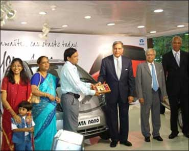 Ashok Vichare, the first owner of Nano, gets the keys from Ratan Tata.