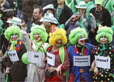 Workers in the non-profit sector, which includes nurses and social workers, dressed up as clowns.