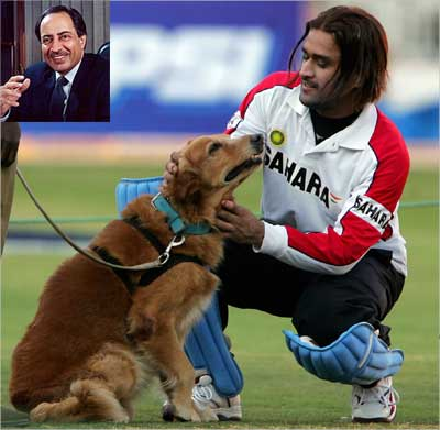 A 2005 file photo of Dhoni playing with a police sniffer dog. Inset: Sanjeev Aga.