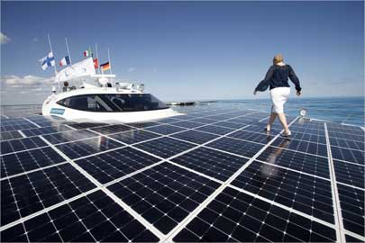A woman walks on the deck of the world's largest solar-powered boat -- The Turanor Planet Solar.