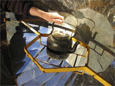 A kettle is placed on a solar cooker in a village in Argentina.