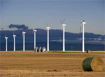 Windmills generate electricity at the foothills of Rocky Mountains, Alberta.