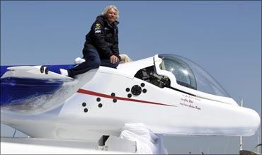 Virgin Group head Sir Richard Branson sits on top of a solo piloted submarine during a photo opportunity at a news conference in Newport Beach, California on April 5, 2011.
