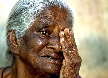 A villager undergoes an eye examination at a camp organised by Aravind Eye Care System in a village.