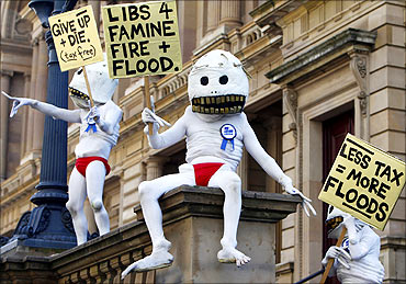 Protesters dressed in costumes are seen at a rally in favour of taxing carbon emissions in Melbourne.