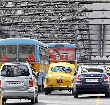 Traffic moves across Howrah Bridge in Kolkata.
