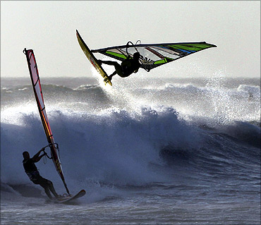 Windsurfers take on the waves at Blaauwberg beach in Cape Town.