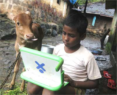 Harish, 11, a school boy uses a laptop provided under the One Laptop Per Child project.