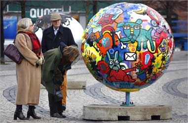 Visitors look at an art installation representing the planet in downtown Copenhagen.