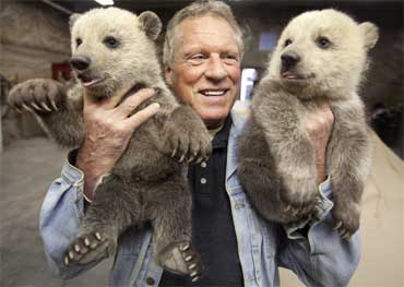 Norman Phillips, owner and operator of the Northwood Zoo with 2 grizzly bear cubs in Seagrave Ontario.