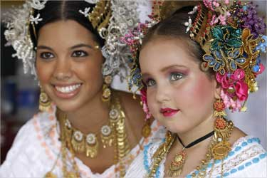 A woman and a child take part in a parade of pollera costumes in the City of Las Tablas, Panama.