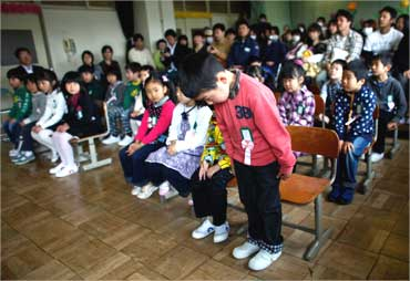 Students at Kamaishi elementary school after the area was devastated by the March 11 earthquake and tsunami.