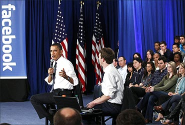 Obama at Facebook headquarters with CEO Mark Zuckerberg.
