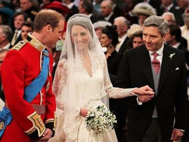 Prince William stands at the altar with his bride, Kate Middleton, and her father Michael.