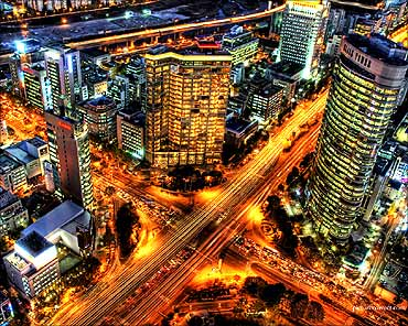 Seoul's roads shine under the lights.