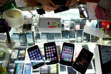 Fake iPhones are displayed at a mobile phone stall in Shanghai.