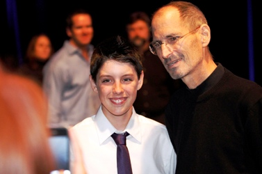 Steve Jobs poses for a photo with Connor Ellison at the Apple Worldwide Developers Conference.