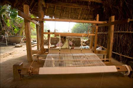 Hand weaving the Malkha fabric.