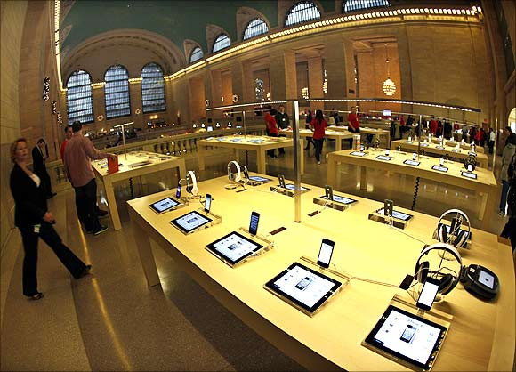 Apple's iPad tablets and iPhones are displayed inside the newest Apple Store in New York City's Grand Central Station.