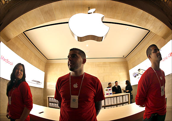Apple employees stand inside the newest Apple store inside York City's Grand Central Station.