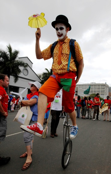 Man on a unicycle takes part in a demonstration by environmental activists outside the United Nations Climate Change conference in Durban.