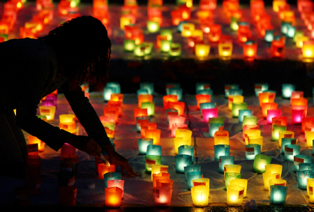 A volunteer sets up candles during Swiss national day in Berne.