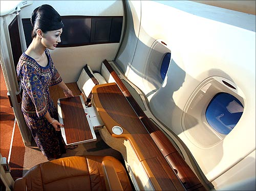 A Singapore Airlines flight attendant demonstrates the features of the first class suite.