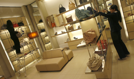 Employees adjust products inside their showroom at the Emporio mall in New Delhi.