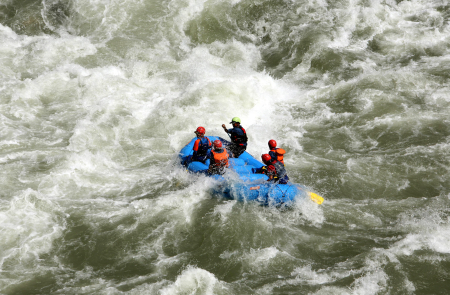 Tourists participate in white water rafting in the Chenab River in Thathri, near Jammu.
