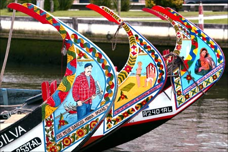 Decorated prows of traditional boats on one of the Aveiro city canals in central Portugal.