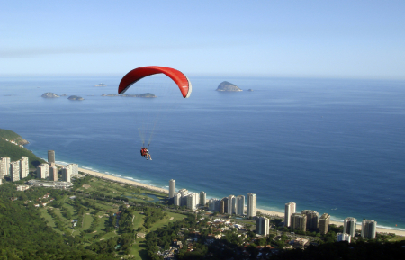 A paraglider soars through the air after jumping off Pedra Bonita in Rio de Janeiro.