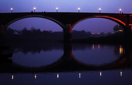 Silhouette of an old bridge over the Kupa River seen at dusk in central Croatian town of Sisak.