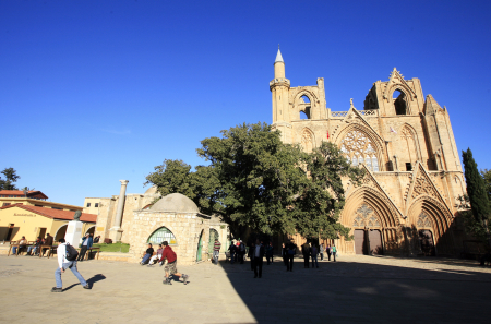 A youth skates past the Lala Mustafa Masha Mosque and a cathedral built by the Lusignans in Famagusta, north Cyprus.