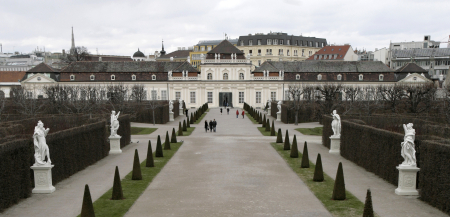 Visitors walk through the park of the Belvedere Museum in Vienna.