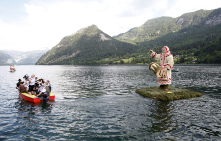 A boat decorated with a traditional carnival figure is seen during a parade in the village of Grundlsee.