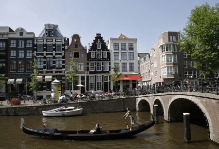 Dutch woman Tirza Mol rows her gondola, the Netherlands' only one, through the canals of central Amsterdam.