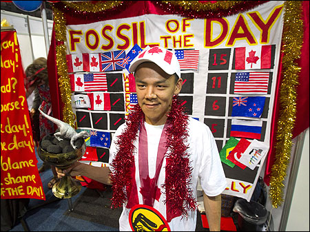 The Colossal Fossil mock award is presented to activist Jordan Konek, an Inuit youth delegate, during COP17 in Durban.