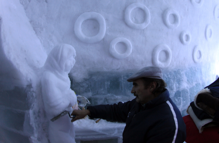 A worker makes an ice sculpture inside a room at the Balea Lac Hotel of Ice in the Fagaras mountains.