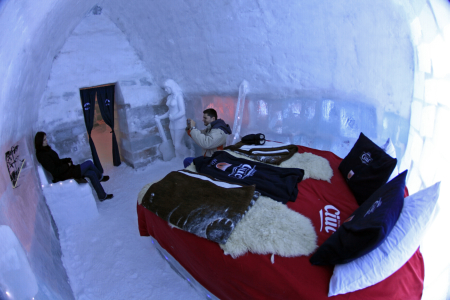 Tourists visit a room inside the Balea Lac Hotel of Ice in the Fagaras mountains.