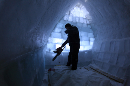 A worker cuts ice inside a room at the Balea Lac Hotel of Ice in the Fagaras mountains.