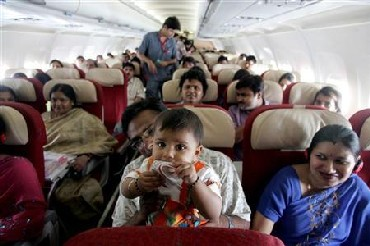 Passengers travel in a Kingfisher Airlines aircraft in the skies over New Delhi