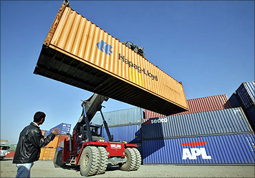 A stacker prepares to stack a container at Thar Dry Port in Sanand in Gujarat.