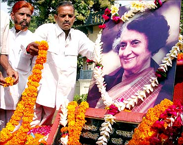 Activists of the Congress party lay garlands before the portrait of former PM Indira Gandhi.