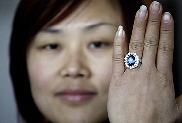 A woman shows a replica of the British royal engagement ring at a jewellery factory in Yiwu.