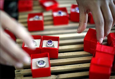 An employee packages replicas of the British royal engagement ring at a jewellery factory.