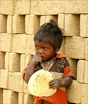 A child of an Indian brick kiln labourer.
